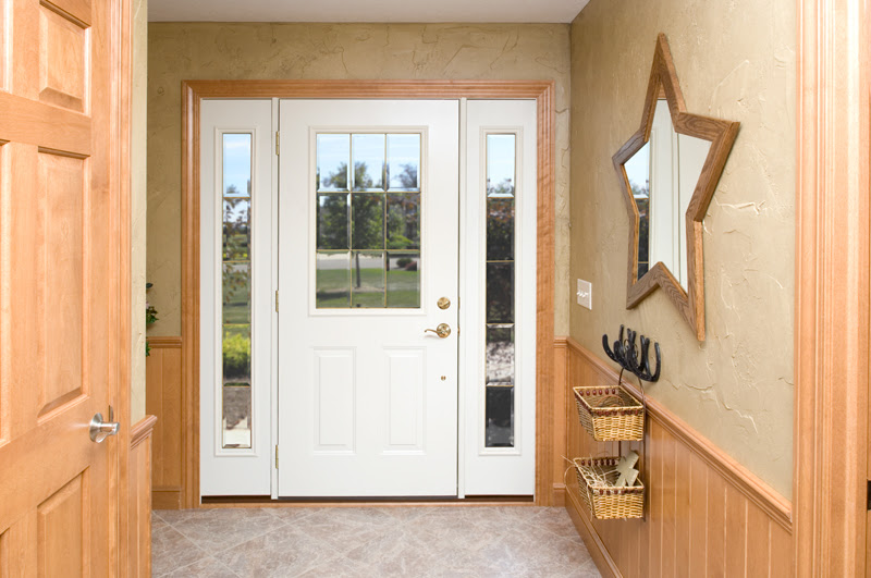 white entry door with windows on both sides, taken from inside the home