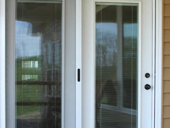white french door with the door handle on the right