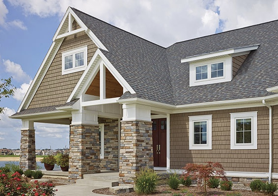 brown shake siding on a traditional two story home