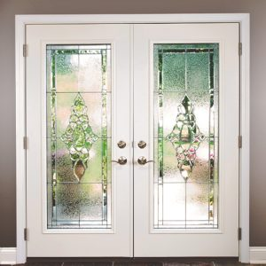 white french doors with one large glass pane on each with a design
