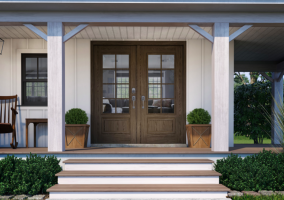 dark brown french doors on a large white house