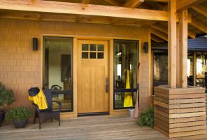 contemporary wood front door with six windows panes on the top of the door